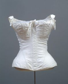 c. 1810-1840; Made in United States Cotton sateen, linen plain weave lining; cotton plain weave tape, baleen, handmade metal eyes, maple busk Philadelphia Museum of Art - Collections Object : Woman's Corset and Busk