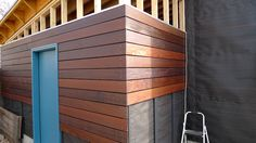 Exterior wood siding panels ortiz mexia projects inc for Modern shed siding