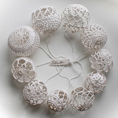 A set of white knitted Christmas decorations /