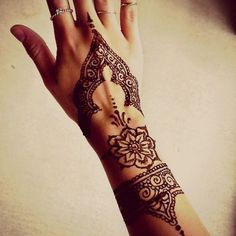 http://tattoomagz.com/ornaments-and-flowers-tattoos/mangala-style-flower-tattoo/