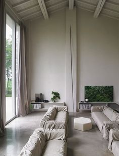 Love the look of these draped sofas - casual but elegant (and could be IKEA Klippans under there!)