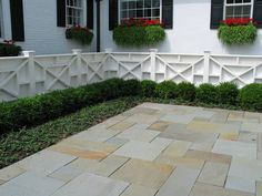 Bluestone, fence and boxwoods