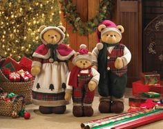 "by Christmas Collection Have a bear-y happy holiday with this cheery trio of bears. Decked in their winter finery, this family features a mama bear, papa bear, and baby bear in festive green and red plaid ensembles with furry trim.  Papa Bear: 13"" x 9"" x 27"" high;  Mama bear: 11"" x 10"" x 28"" high;  Baby bear: 11"" x 6"" x 20"" high. ​   allgooddecor.com #allgooddecor #decor #candles #accents #figurines #furniture #gifts #decorations #lighting #mirrors #fountains #outdoor #toys"