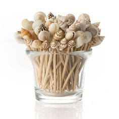 Idea for my huge shell collection...glue shells onto chop sticks for drink stirrers
