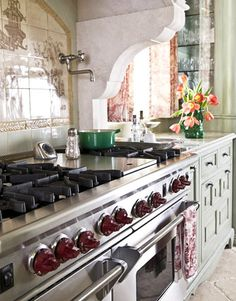 """Tile Mural  A hand-painted tile mural from the Chinoiserie series by Tempest, available at Architectural Design Resource, accents the 60"""" Dual Fuel range by Wolf. Harrington Brass Works pot filler in satin nickel."""