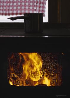 A pot of boiling water to fight the cold (and fire in the woodstove)