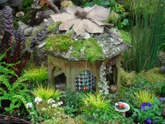 A fairy house part of the Enchanted Food Forest at www.abundantnaturegarden.com
