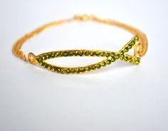 Christian Bracelet Fish Ichthys Green Ictus Ichthus Jesus Fish Christian Symbol. $19.99, via Etsy.
