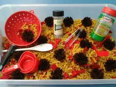 """""""pasta dinner"""" sensory bin: uncooked pasta (any kind except spaghetti because it easily breaks), brown pom poms, colanders, empty parmesan cheese containers, spoons, etc."""