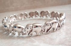 Sterling Elephant Bracelet Hinged Bangle 7.5 Inch 10mm Wide Vintage AT0285 by cutterstone on Etsy #elephants #sterlingsilver #vintagebracelet #silverbracelet #pachyderms