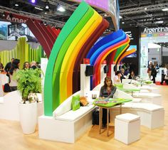 Colorful Booth Design #rainbow #exhibit #tradeshow coroplast blues and whites across piping...