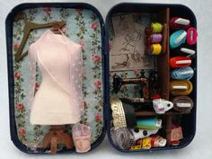 This darling altered Altoid tin depicts the interior of your favorite tailor shop. Complete with rolls of fun fabric, this is a perfect gift for the seamstress in your life!  These re-purposed Altoid Tins measure just 3 ½ inches high, 2 ½ inches wide, and ¾ inch deep.  This is a special order item, Please allow 2-3 weeks for delivery. Your order may differ slightly.