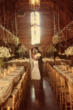 Love this wedding shot with no one else around. A deserted wedding with gold, lights, romance