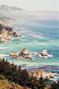 Big Sur is a sparsely populated region of   the Central Coast of California where the Santa Lucia Mountains rise abruptly   from the Pacific Ocean.