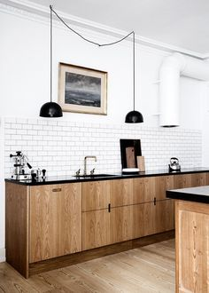 Danish Kitchen, Modern Kitchen, Minimal Kitchen, Scandinavian Kitchen, Scandinavian Interiors, Scandinavian Design, Scandinavian Interior Design, Oak Kitchen Cabinets, Black Countertops, Metal Pendant Light, Black Metal Pendant Light, Dome Pendant Light, Subway Tile, Black Grout. Brass Faucet, KBH Københavns Møbelsnedkeri