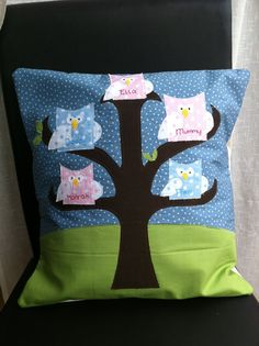 Family tree cushion, starry sky with owls on the tree. Personalised with hand embroidered names. £30.00, via Etsy.