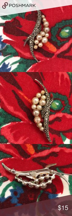 Vintage marcasite and pearl brooch Vintage marcasite and pearl brooch. I did glue a few pearls back in place. Third pearl from bottom has slight peeling on faux pearl. Stamped Vogue Jlry on back. Vintage Jewelry Brooches