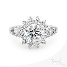 Loving this new design with an accentuated diamond halo. www.yorkjewellers.com.au