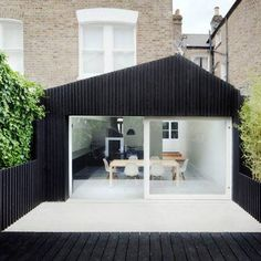 black timber clad extension to victorian terrace