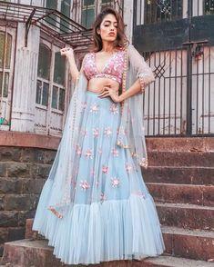 A stunning dusty blue and pink lehenga for the perfect bridesmaid look. #lehenga #PapaDon'tPreach #bridesmaid #bridesmaidoutfits #mehendi #mehndioutfits #sangeet #sangeetoutfits #engagement #engagementoutfit #unique #outfitideas #sagan #cocktail #shaadisaga #bride #bridestyle #lehenga #gown #weddinginspo #weddinginspiration #mehendioutfit #ethnicwear