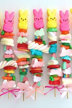 Easter Candy Kabobs: Make as gifts for kids by buying Easter candy and gummies in bulk, and then stacking cute clusters on kabob sticks. Click through for more Easter party ideas and decorations that your kids and family will love.