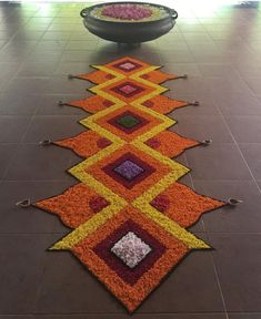 Marigold Floral Rangoli by Touch Aesthetics-Kerala. Rangoli Designs Simple Diwali, Rangoli Designs Flower, Rangoli Border Designs, Small Rangoli Design, Rangoli Patterns, Colorful Rangoli Designs, Rangoli Ideas, Beautiful Rangoli Designs, Flower Rangoli