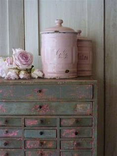 Gorgeous distressed dresser. The pink paint is understated but blends the dresser and the rest of the room perfectly.