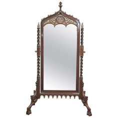 View this item and discover similar for sale at - An exquisitely carved mahogany, Neo-Gothic cheval mirror, which may be Iberian. The gilding is over red bole, and the mirror pivots on finely-cast, gilt-bronze Mirrored Furniture, Antique Furniture, Furniture Decor, Modern Furniture, Modern Floor Mirrors, Cool Mirrors, Large Dining Room Table, Cheval Mirror, Frameless Mirror