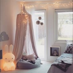 Going to do a papasan pillow with gauze canopy similar to this.
