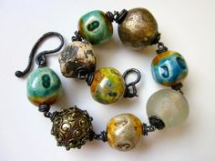 Non Serviam -primitive assemblage chunky blue green amber typeface ceramic bead, brass, antique African trade bead, oxidized copper bracelet by LoveRoot