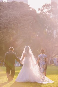 Bride walks down the aisle with both parents. A Spring Garden Wedding in Sydney: Riszal and Sook. Jenny Sun Photography #jennysun http://www.theweddingscoop.com/entry/a-spring-garden-wedding-in-sydney-riszal-and-sook