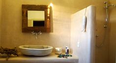 Drios, Paros island, Greece. Cement mortar and aged marble sink in a traditional built bathroom.