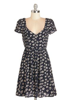 Peace of Mind Dress. With just one glance at the floral print on this navy-blue dress, your mood is lifted to harmonious heights! #blue #modcloth