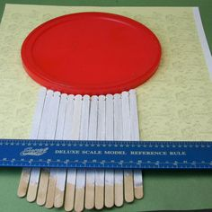 Set the tops of the stir stick pickets along the edge of a coffee lid or a plate to make a curved top picket fence or wainscoting for a dolls house.