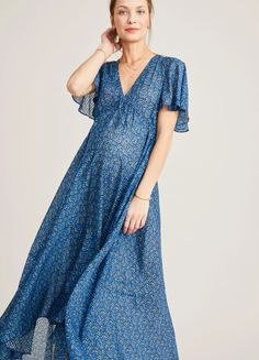 Feminine and flattering, an endlessly versatile floral dress with a flounced seam, flutter sleeves and high-low hem made for catching spring breezes. Casual Maternity Dress, Stylish Maternity, Maternity Fashion, Maternity Outfits, Maternity Style, Pregnancy Fashion, Pregnancy Outfits, Maternity Photos, Casual Summer Outfits For Women