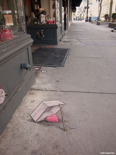 Sluggo putting it all out there on the street and hoping for the best. David Zinn, 2012 at The Peaceable Kingdom, Ann Arbor, MI