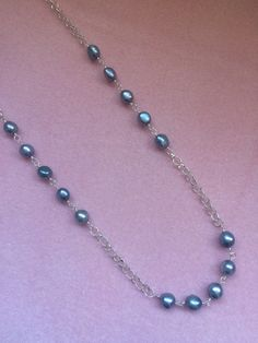 A personal favorite from my Etsy shop https://www.etsy.com/listing/273982070/grey-freshwater-pearl-and-sterling