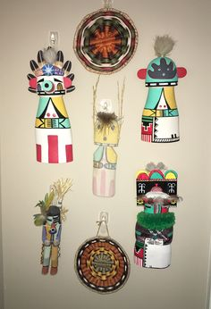 Wall arrangement of Hopi flat dolls and wicker basketry.