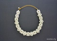 The  Pearl Ball Choker Necklace from J.Crew is gorgeous, but at nearly $200, it can easily go over your gift budget. Make this DIY pearl necklace instead for a fraction of the price!  Find  full instructions at Delightfully DIY.