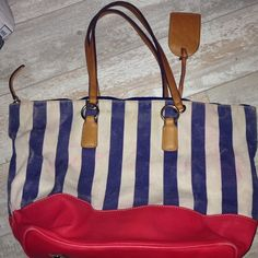 Dooney and Brouke stripe canvas leather tote bag Dooney and Brouke stripe canvas leather tote bag   Pre Owned  No dust bag  Has swing Tag  has feet  color transfer from leather in canvas  stitching and cornors are tight  liner very clean  zipper runs smooth Dooney & Bourke Bags