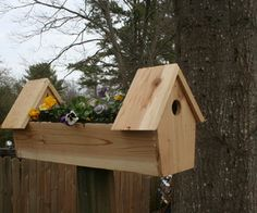 DIY Cedar double bird house planter - Nothing symbolizes the onset of spring more than flowers and birds. As soon as we see those first blooms in March and hear the chirping outside of our windows, we know warm weather is on the way. Bird Feeder Plans, Bird House Feeder, Bird Feeders, Outdoor Projects, Wood Projects, Outdoor Decor, Furniture Projects, Pallet Furniture, Birdhouse Designs