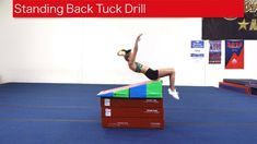 Standing Back Tuck Drill A good set and take off position is important to gain the height necessary for a standing back tuck. Using a stack of Booster Blocks. Gymnastics Lessons, Boys Gymnastics, Gymnastics Floor, Gymnastics Tricks, Tumbling Gymnastics, Gymnastics Coaching, Gymnastics Training, Gymnastics Workout, Olympic Gymnastics