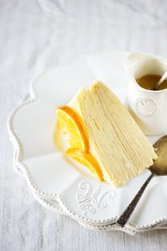 crepe cake with vanilla pastry cream, oranges and orange butter sauce.