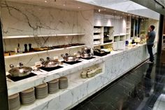 The buffet counter is divided into three sections. The first section has three chafing dishes with hot entrees, a soup, and several breads and yummy looking pastries. Hotel Breakfast, Breakfast Buffet, Hotel Buffet, Modern Minimalist Bedroom, Counter Design, Wall Shelves Design, Restaurant Design, Fine Dining, Home Kitchens