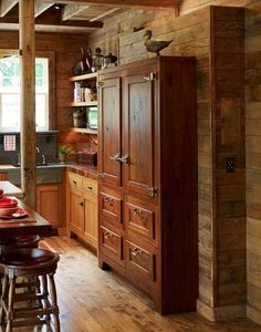 that stunning piece is the refrigerator in this beautiful kitchen. love it