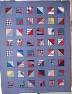 Half square triangles from men's recycled shirts. I love shirtings. Love this easy quilt.