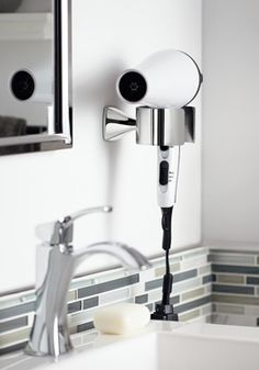 Hang your hair dryer with a hotel-style fixture next to the mirror.