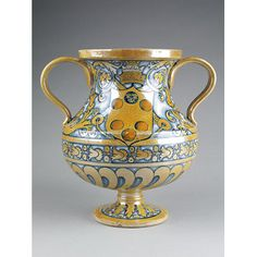 Vase ~ Deruta, Italy ~ 1513-1534 ~ Two-handled vase of tin-glazed earthenware, painted in colours and lustre, featuring the arms of the Medici Pope Leo X (r. 1513-21) or Clement VII (r. 1523-34).