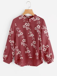 Long Sleeve Blouses. Top Decorated with Button. Designed with Band Collar. Regular fit. Perfect choice for Casual wear. Floral design. Trend of Spring-2018, Fall-2018. Designed in Multicolor. Fabric has no stretch.