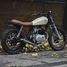 Check out this killer Yamaha SR250 by @auto_fabrica. Tan seat and matching grips make everything look better! #croig #cafersacersofinstagram by caferacersofinstagram http://ift.tt/1v5ViOh